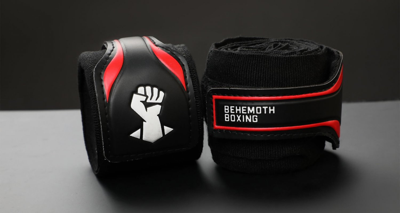 Behemoth Boxing logo design shown on black handwraps