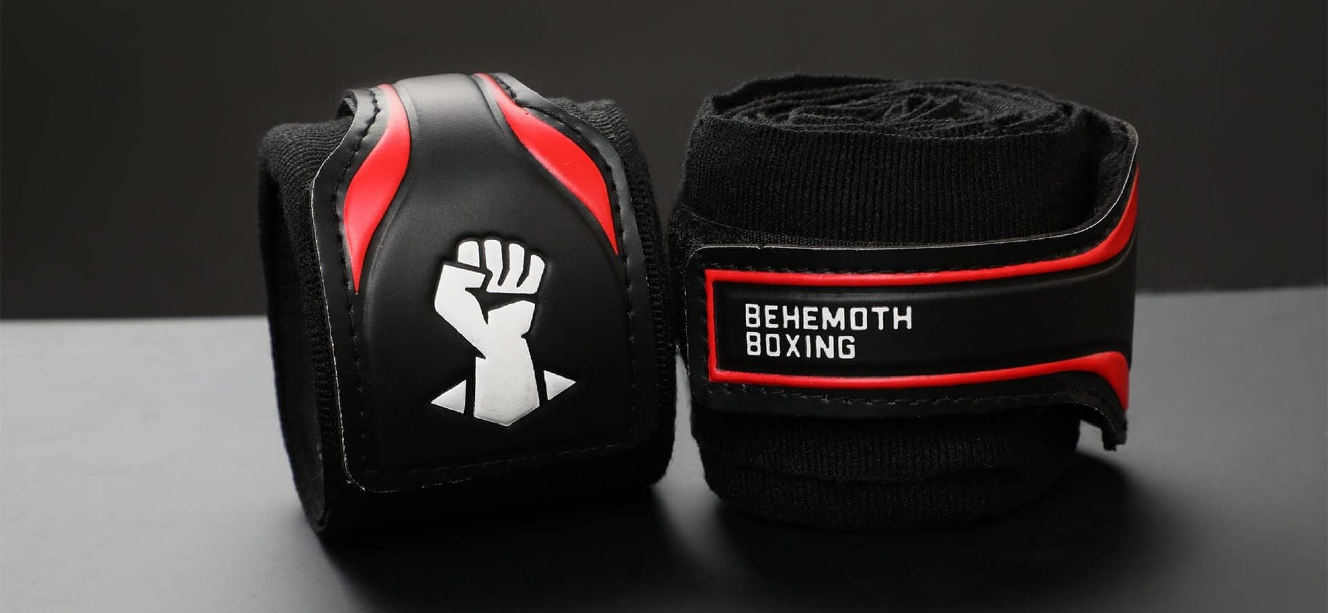 Behemoth Boxing logo design shown on black handwraps