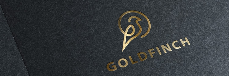 Logo design debossed onto matte black paper